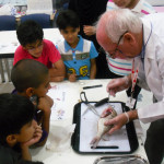 Mike doing a fish dissection at the Bahrain Science Centre during his employment with MTE Studios.
