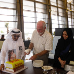 Mike cutting his farewell cake with Farooq al-Janahi  at the conclusion of his contract at the 'Museum of Science & Technology in Islam' in Saudi Arabia while in the employment of MTE Studios. His right hand is bandaged after a bicycle accident in the Arabian desert.