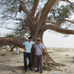 Mike with his son, Ryan, at the 'Tree of Life' in the Bahrain desert in 2013.