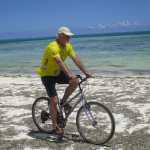 Mike surveying traditional fishing techniques by bicycle along the beach in Zanzibar in December 2013.